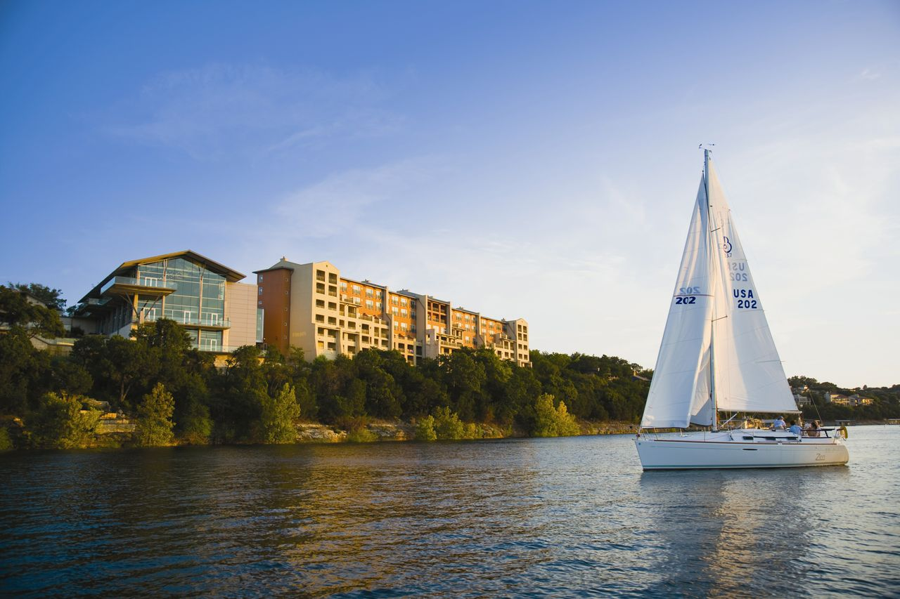 Sailing past the Lakeway Resort and Spa on the south shore of Lake Travis