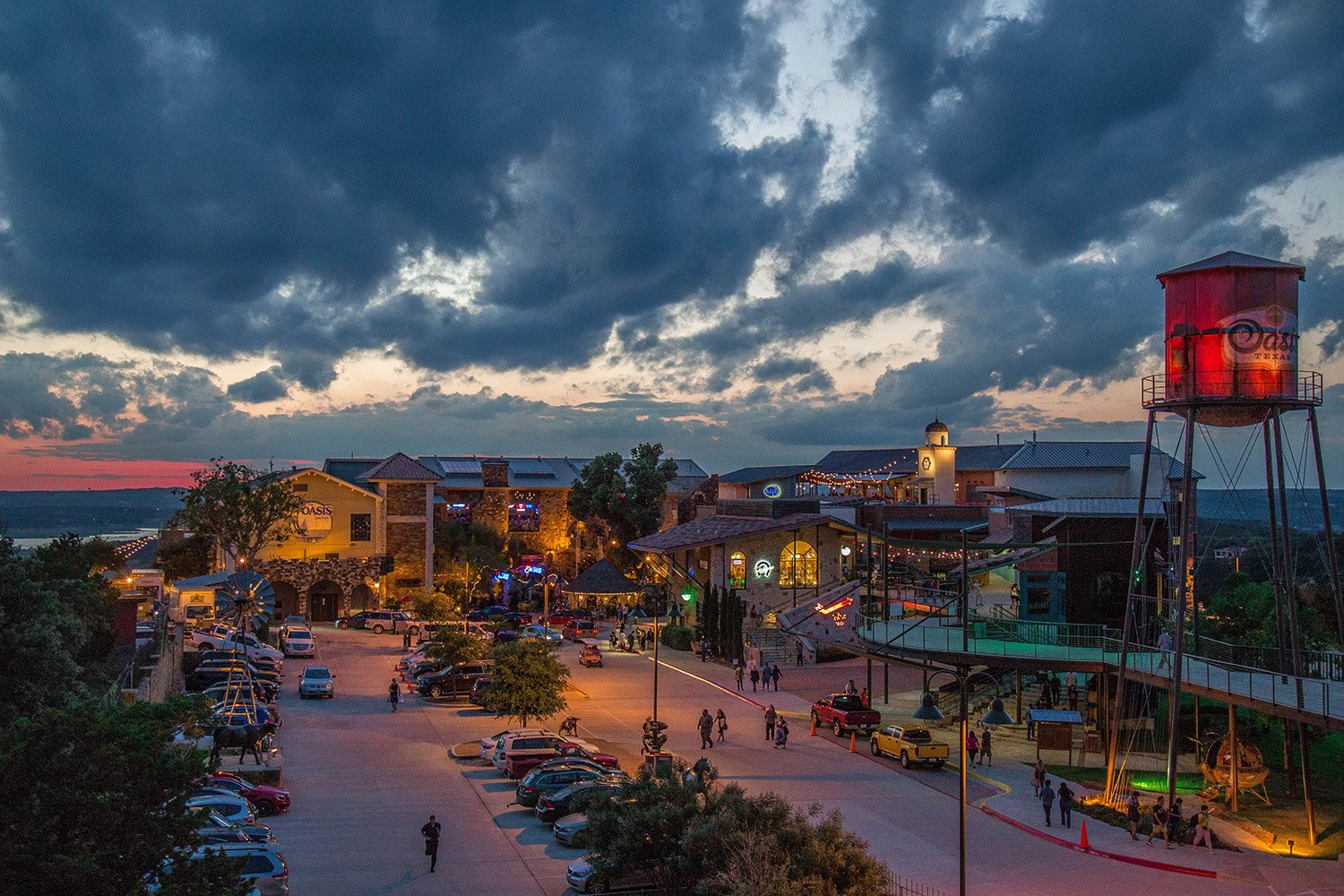 Restaurants and retail make up the bustling Oasis TX entertainment complex perched 450 above the waters of Lake Travis.