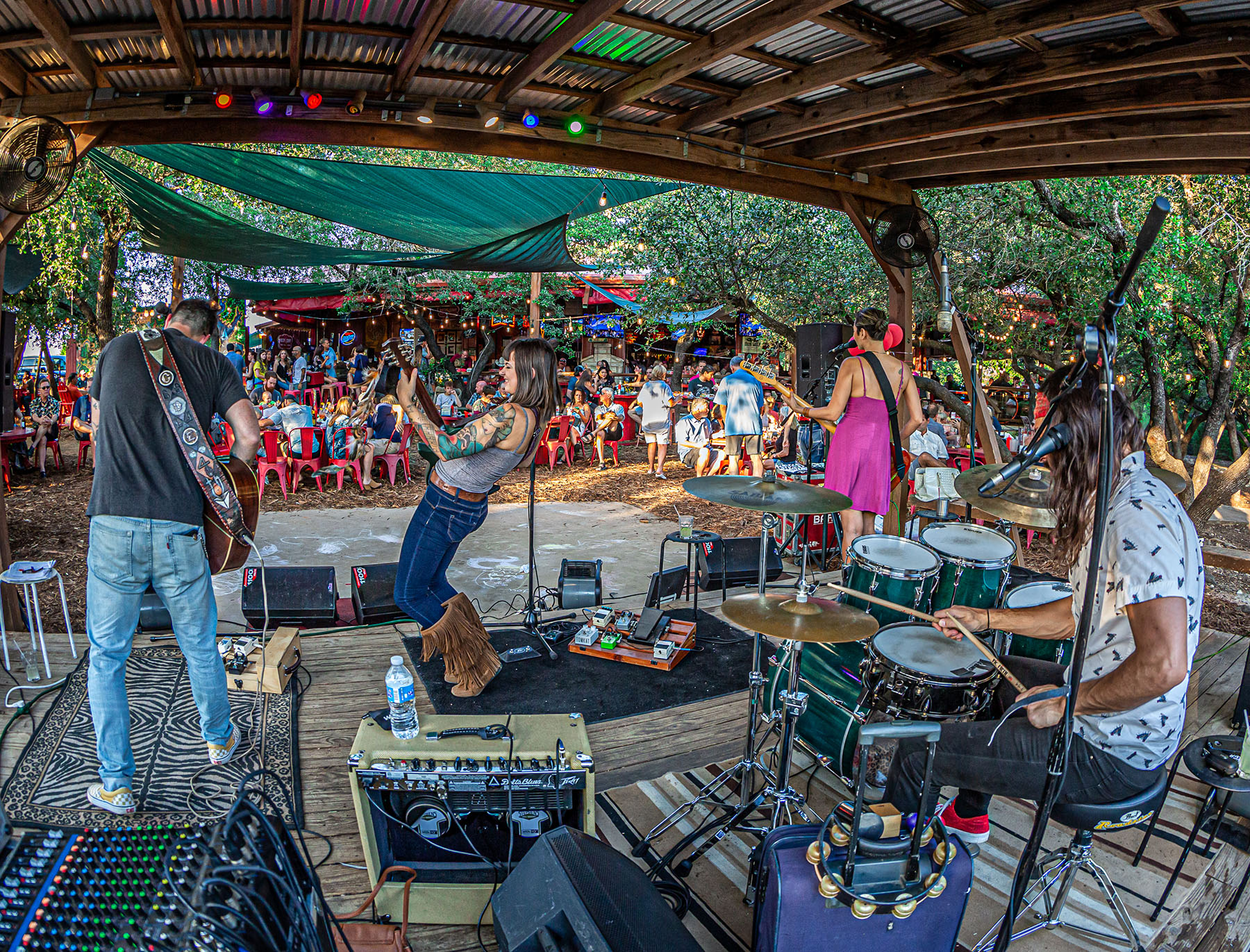 Live music under the palapa at Angel's Icehouse in Spicewood.  Photo: Will Taylor - LakeTravis.com