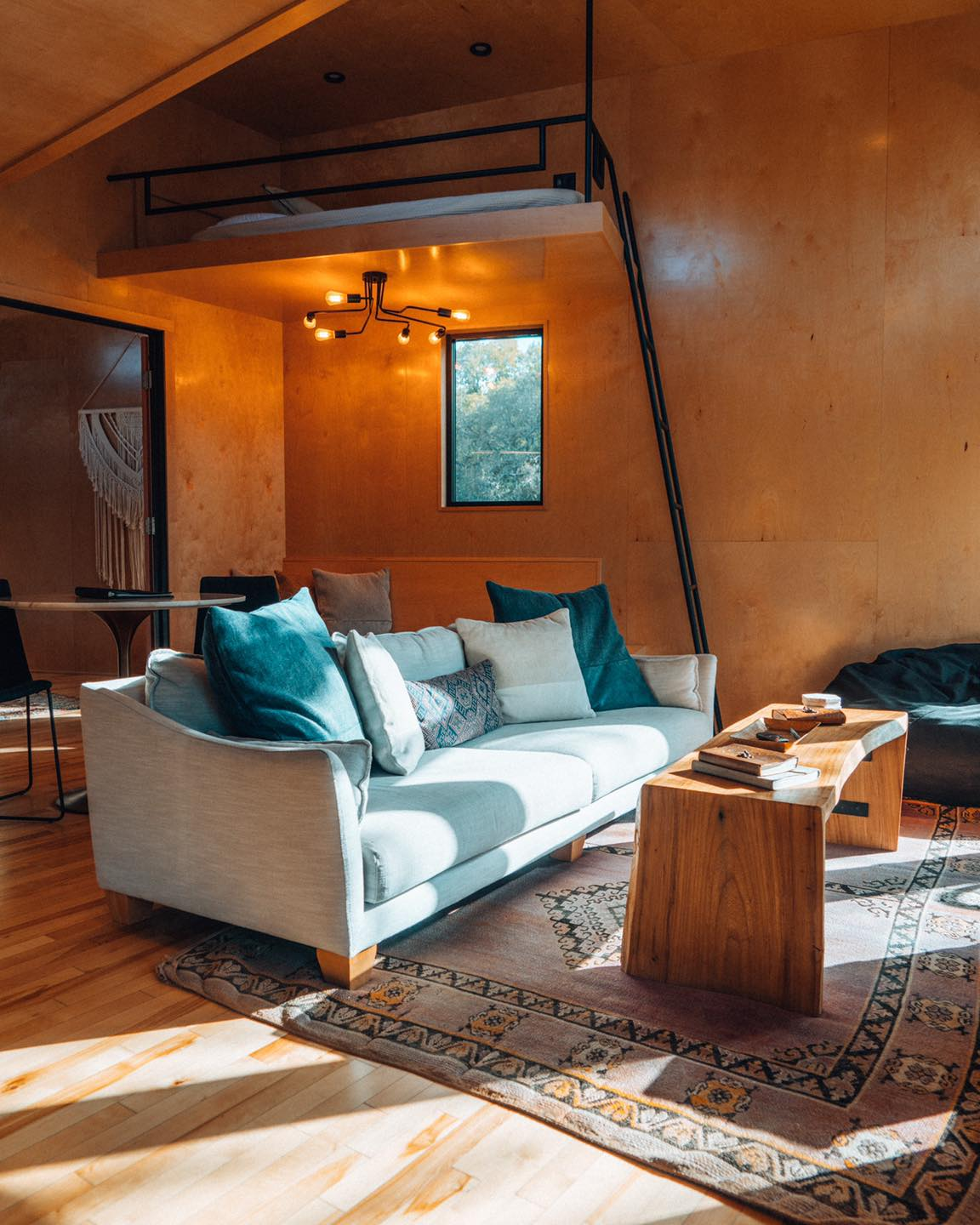 Living room in Cypress Valley's Yoki treehouse.