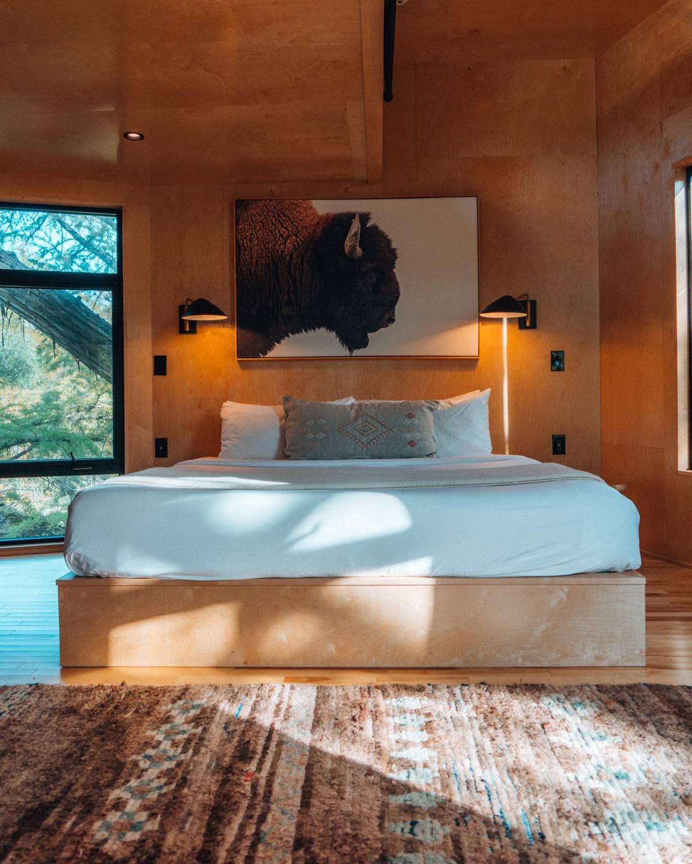 Bedroom in Cypress Valley's Yoki Treehouse.