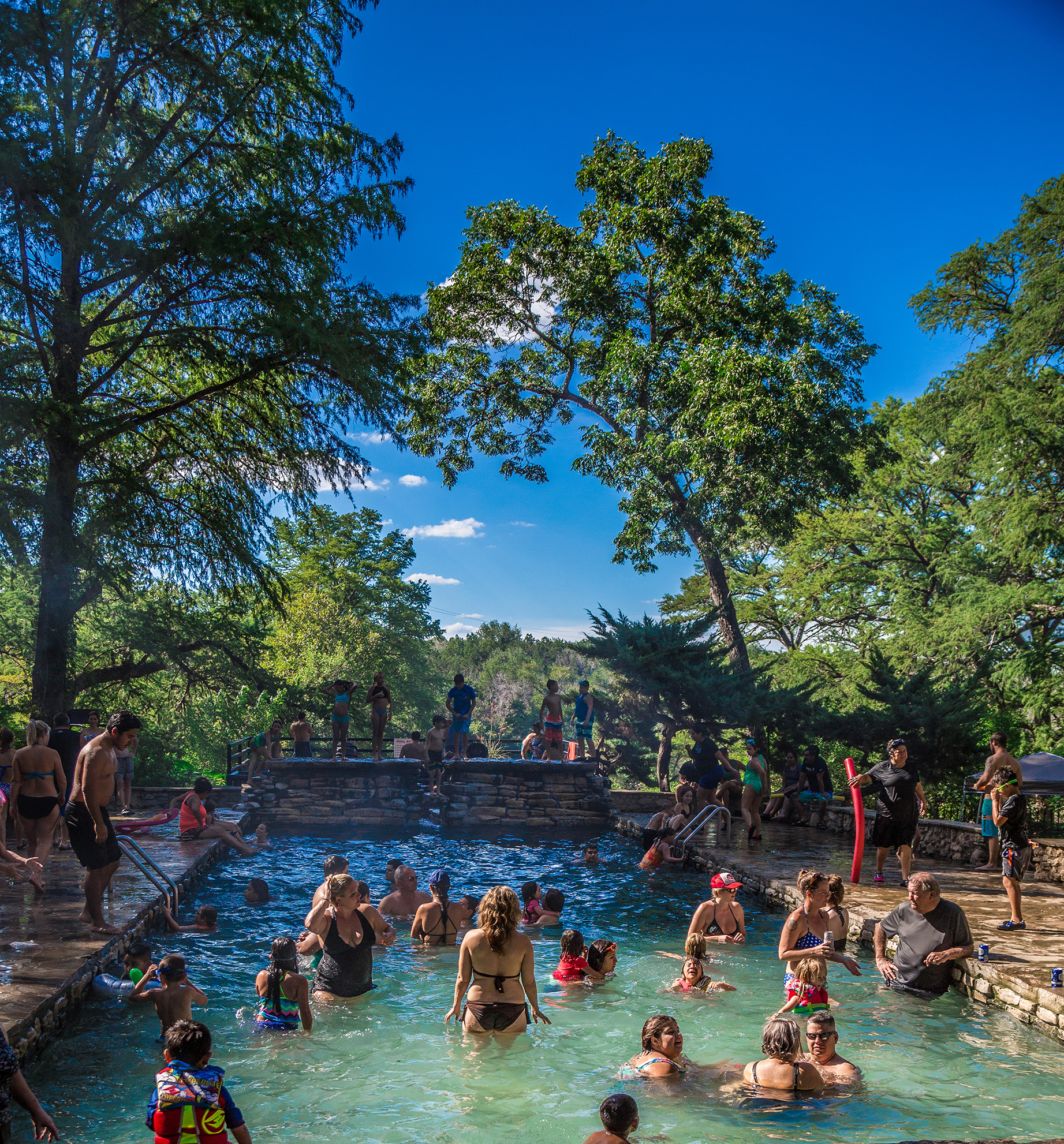 Wading in the upper springs at Krause Springs.  Photo: Will Taylor - LakeTravis.com
