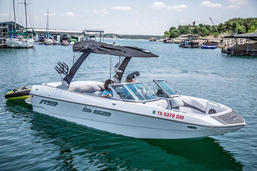 Lakeway Marina Wake Boat rentals come with a driver and toys.