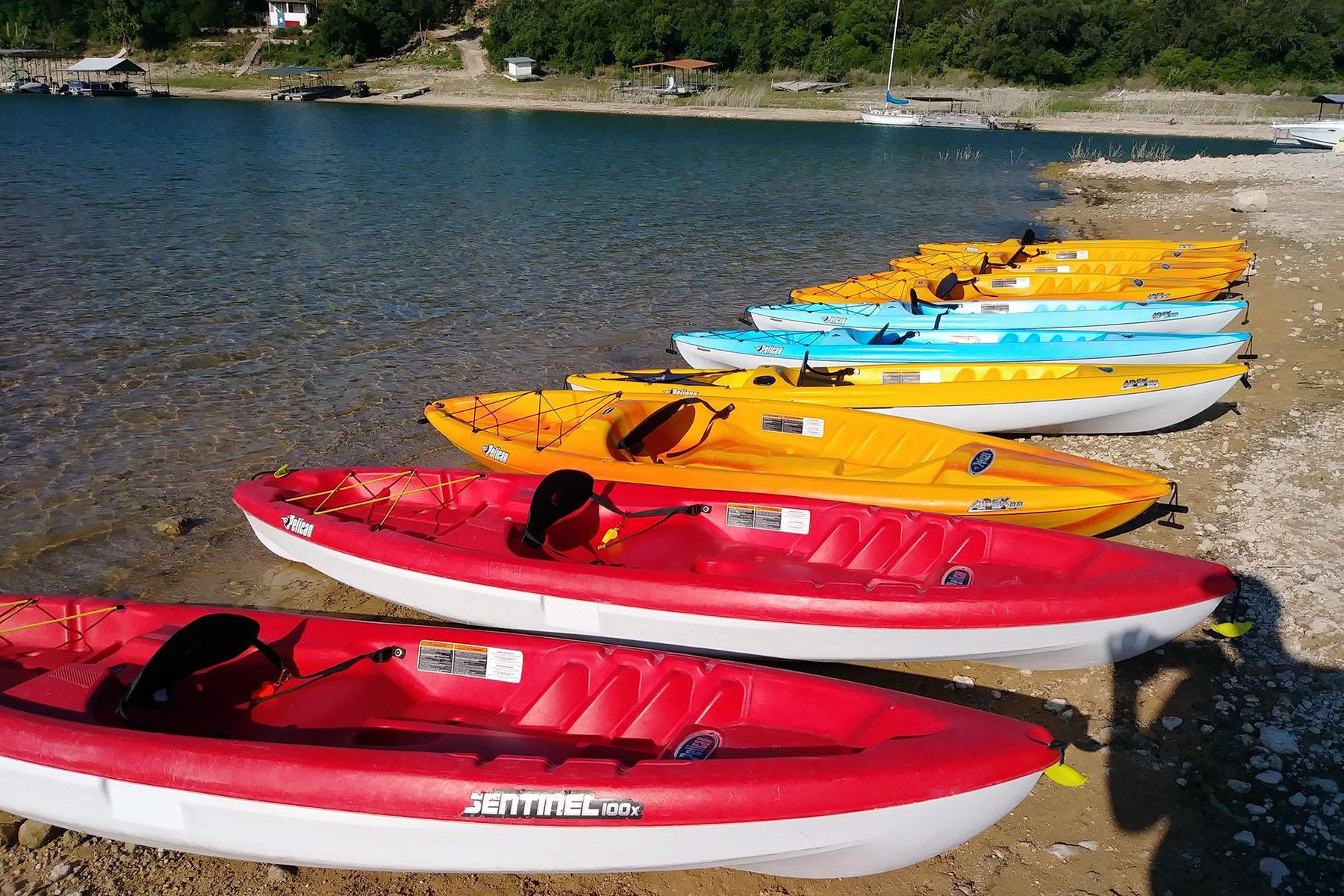 Just some of the fleet at Viking Ship Kayak Rentals on Lake Travis.
